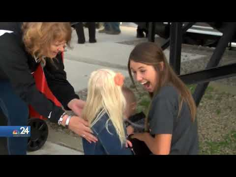 Liberty Center homecoming queen invites children with Down Syndrome to join her court.