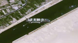 Download Cargo ship blocking Suez Canal costs billions in delays of goods