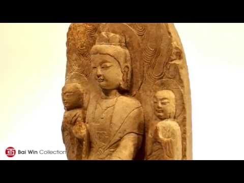 Northern Wei Dynasty stone Buddha with two guardians.
