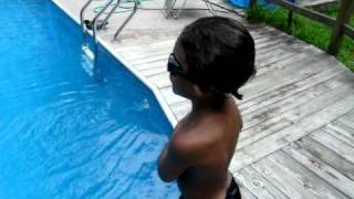 4 year old swimming in water to bottom of 12 feet in deep end of pool