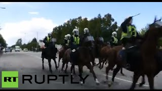 Horse police trample anti-Nazi rally in Sweden