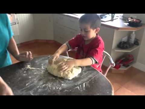 Olly making Rewana bread from Cameron Petley's cookbook.