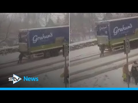 Woman spotted 'pushing' lorry up snow-covered hill