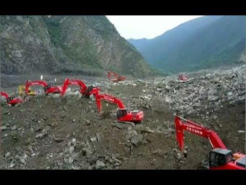 Three survivors and 15 dead in massive China landslide