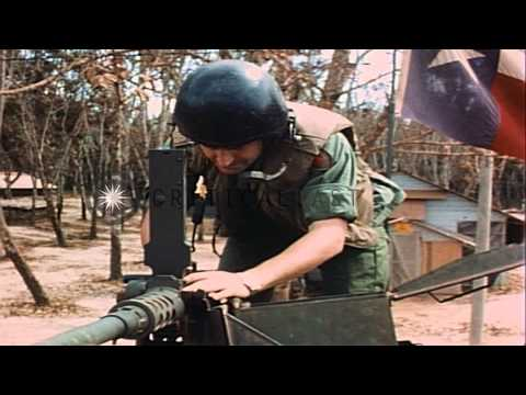 Crew members put on tanker's helmet and get inside M-48 tank in Lai Khe, South Vi...HD Stock Footage
