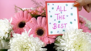All the best message card with a beautiful bouquet of pink and white flowers