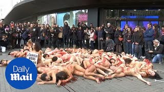 Naked activists cover themselves in fake blood in Barcelona protest