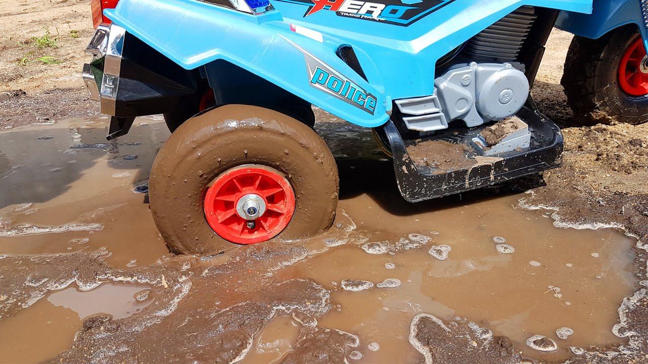 Power wheels police bike stuck in the mud