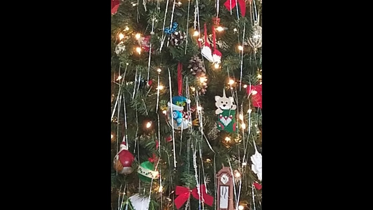 Rotating Christmas Tree with White Lights Red Bows Holographic Icicles - YouTube