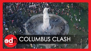 Violent Clashes As Protesters Try to Tear Down Chicago's Christopher Columbus Statue