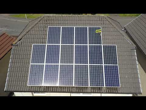 Cleaning solar panels with brush on a telescopic pole