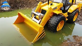 The bulldozer is in the mud. Construction site toy video for children.