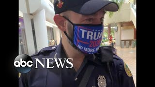 Police officer faces disciplinary action for wearing Trump mask while voting