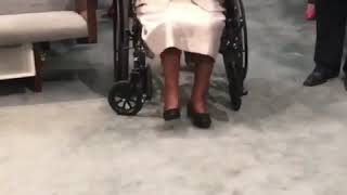 (Older lady in church) breaks out dancing in wheel chair