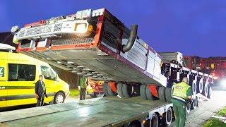 Heavy Transport: Self proprelled transporter (SPMT) driving on a trailer