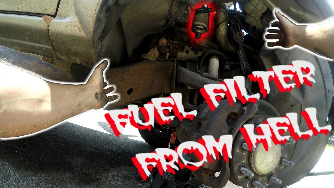 how to remove stuck a fuel filter on a duramax [ 1280 x 720 Pixel ]