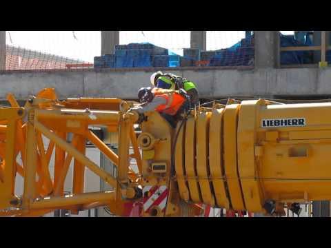 Adding a luffing jib assembly to massive Liebherr crane.