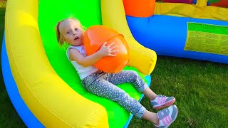 Alice has Fun Playtime with Color Eggs on Giant Inflatable Slide