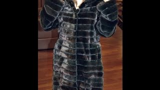 The BRASCHI brand a mink fur coat with a hood evergreen color model 2015.