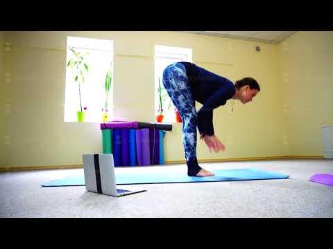 Businesswoman studies basic yoga exercises on online course