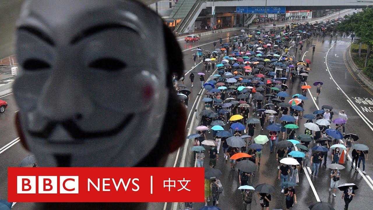 蒙面法:示威者反「禁蒙面法」上街 解放軍營發警告- BBC News 中文 - YouTube