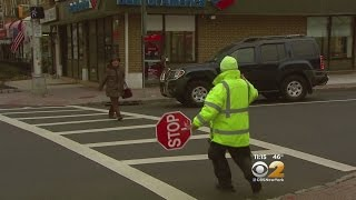 Crossing Guard Risks Life