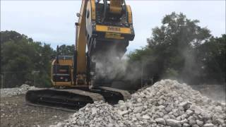 mb crusher on cat excavator at thompson tractor crushing rock