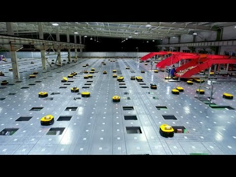 Watch an army of robots efficiently sorting hundreds of parc