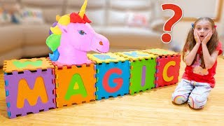 Alicia's funny adventure with magic boxes. Alicia plays with ABC puzzle mat