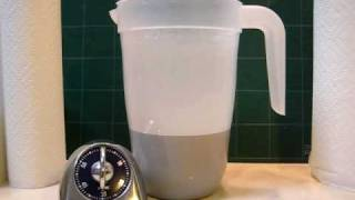 Aluminum Oxide (1000 mesh) Sedimentation - 60 Minutes(12 ounces of 1000 mesh aluminum oxide abrasive that was used for 10 days in polishing a batch of rocks. Aluminum oxide is suspened in 2 quarts of water., 2008-12-06T20:56:35.000Z)