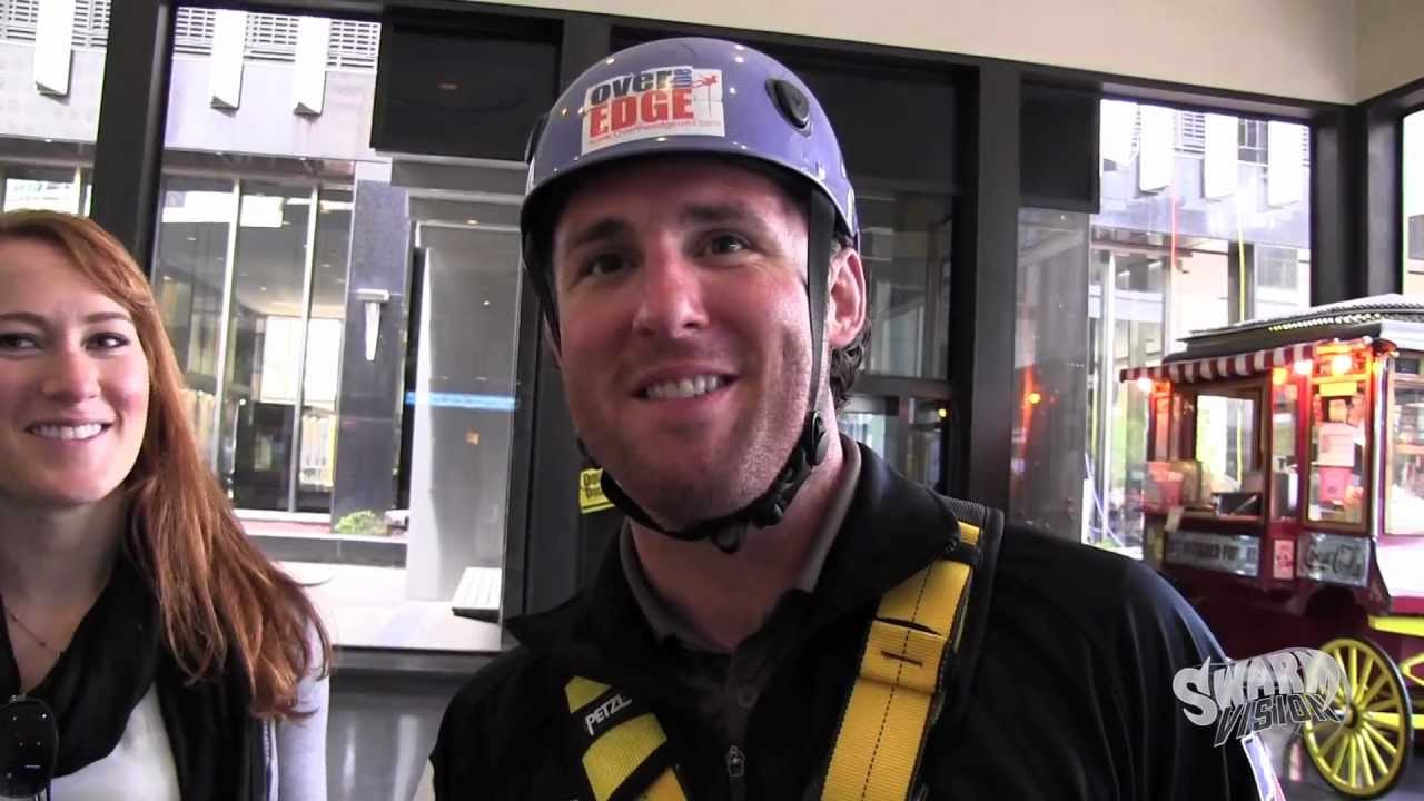 swarm co owner andy arlotta rappels down a story building in st swarm co owner andy arlotta rappels down a 22 story building in st paul