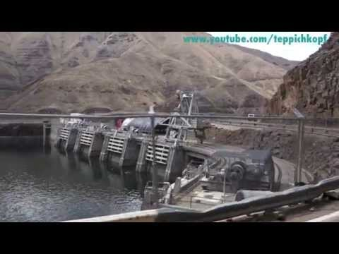 Brownlee Dam - driving past huge earth embankment dam on Hwy 71 Snake River Canyon Idaho