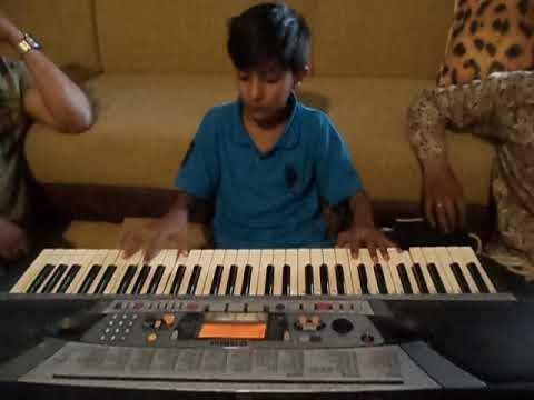 My Son playing piano theme  Ballade pour Adeline by  Richard Clayderman