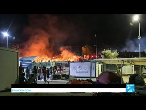 Greece: Migrants flee burning camp on Lesbos island
