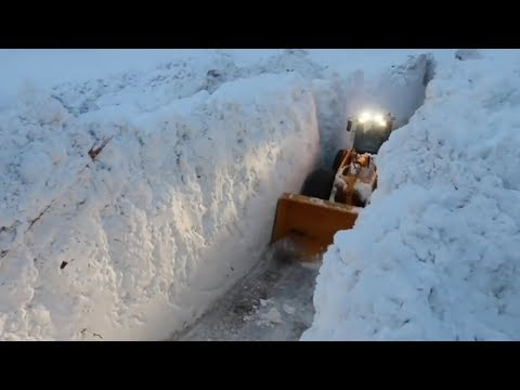 Rescue crews create corridors of snow as they try to reach tourists trapped in French Alps