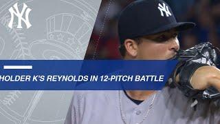 Holder strikes out Reynolds after a 12-pitch battle