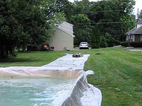 Back 40 redneck slip n slide with splash pool youtube for How to build a swimming pool slide