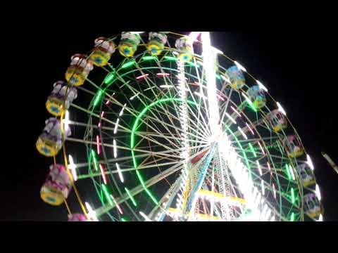 Kids scream in a giant wheel, Indore