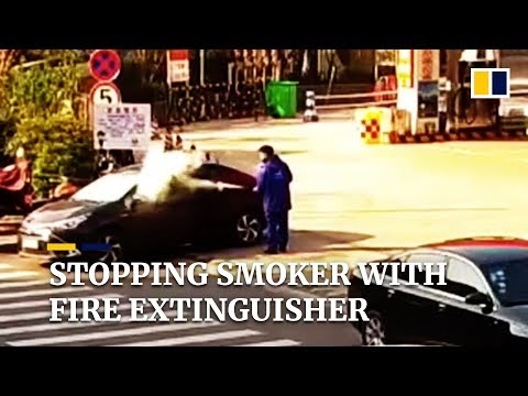 Petrol station worker uses fire extinguisher to stop smoker