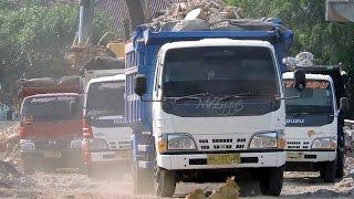 Overloaded Dump Truck Moving Demolition Debris