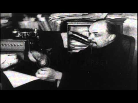 Bolshevik leader Vladimir Lenin speaks sitting in his office in Moscow, after the...HD Stock Footage
