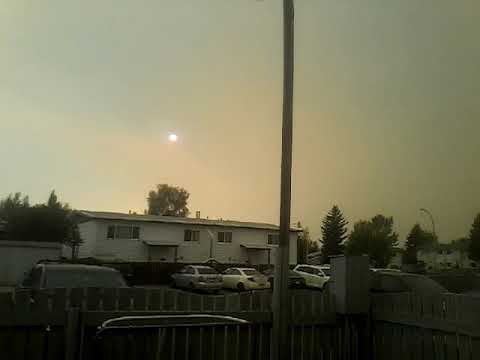 Red sun  from waterton wildfire 2017 bringing huge plumps of smoke in the praries