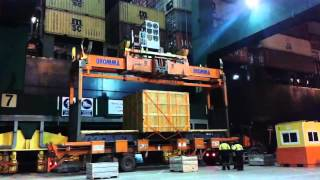 Oversize flat rack container loading on board container vessel.