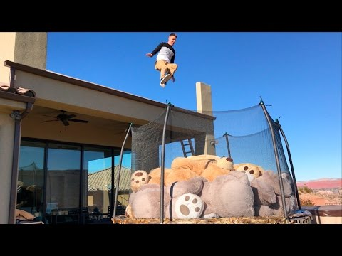 Roof Jumping into Trampoline full of 10 GIANT Teddy Bears!