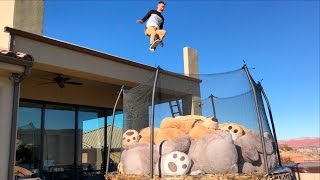 Roof Jumping into Trampoline full of 10 GIANT...