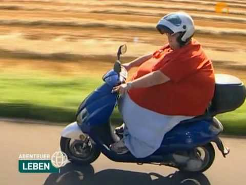 Funny fat woman on motorcycle