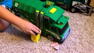 toy garbage truck in action side loader