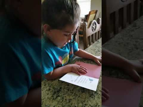 Bella reading grandmas bday card 2018