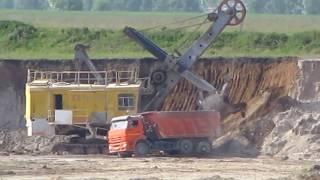 EKG-5 shovel loads overburden on KAMAZ-6520 truck