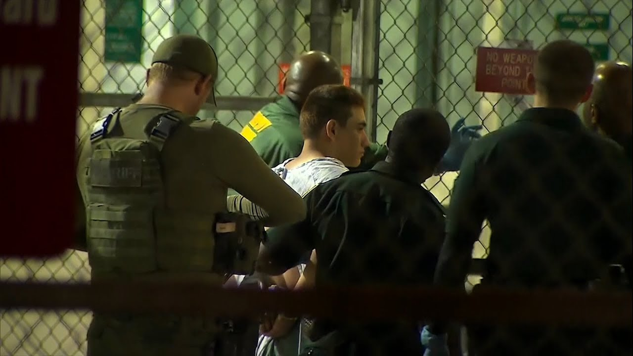 Moment Florida school shooting suspect taken to jail